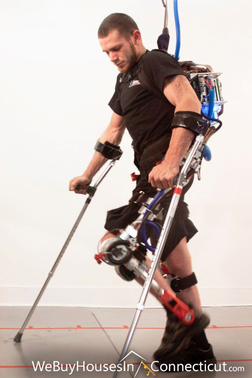 Paraplegic Person Walking in an Exoskeleton Robotic Suit