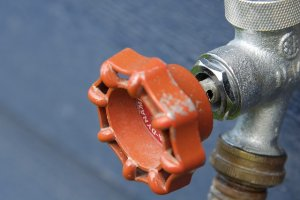 turn off and winterize outdoor hoses - home maintenance checklist for vacant houses on Long Island