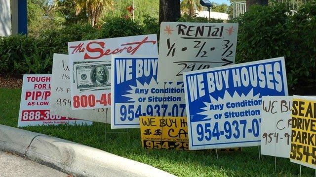 we buy houses bandit signs