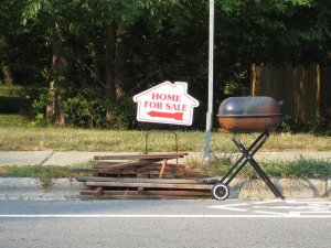 "A ""home for sale"" sign left by a realtor"