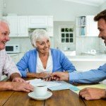 ways to tell real estate agents and investors apart | old couple smiling meeting