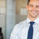 Should I Hire A Real Estate Agent To Sell My Home | smiling white businessman
