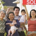 cash for houses in | happy family holding sold sign