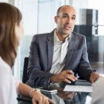 advantages of selling to an investor over a traditional buyer | business meeting