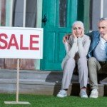 How Long Does It Take To Sell My House | frustrated couple sale sign