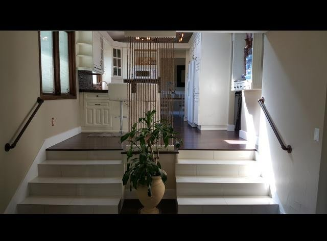 Dual staircases in a home in Sandy UT with seller financing