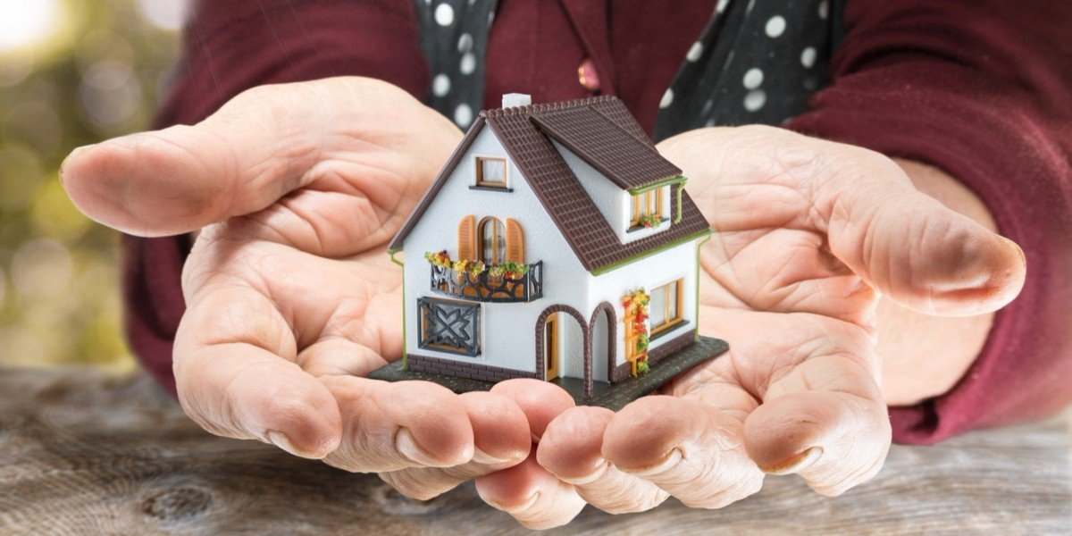 What happens when you inherit a house   hands holding model home