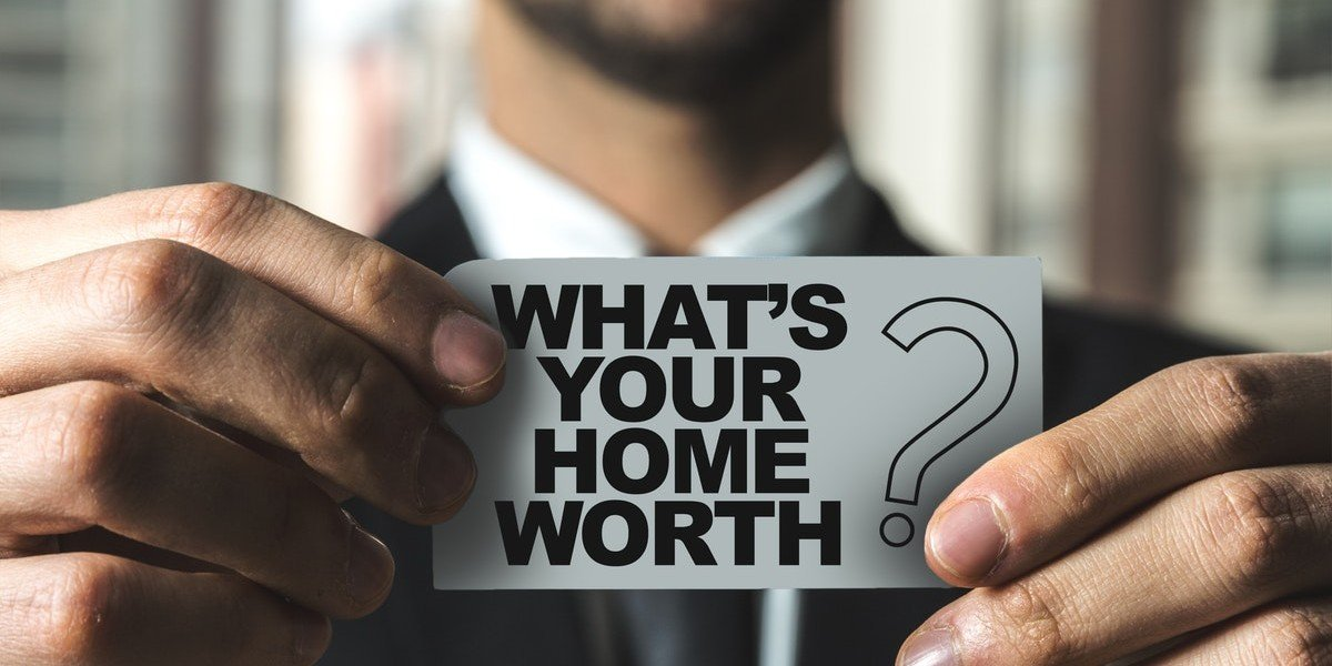 Would An Investor Buy My House | man holding home worth card