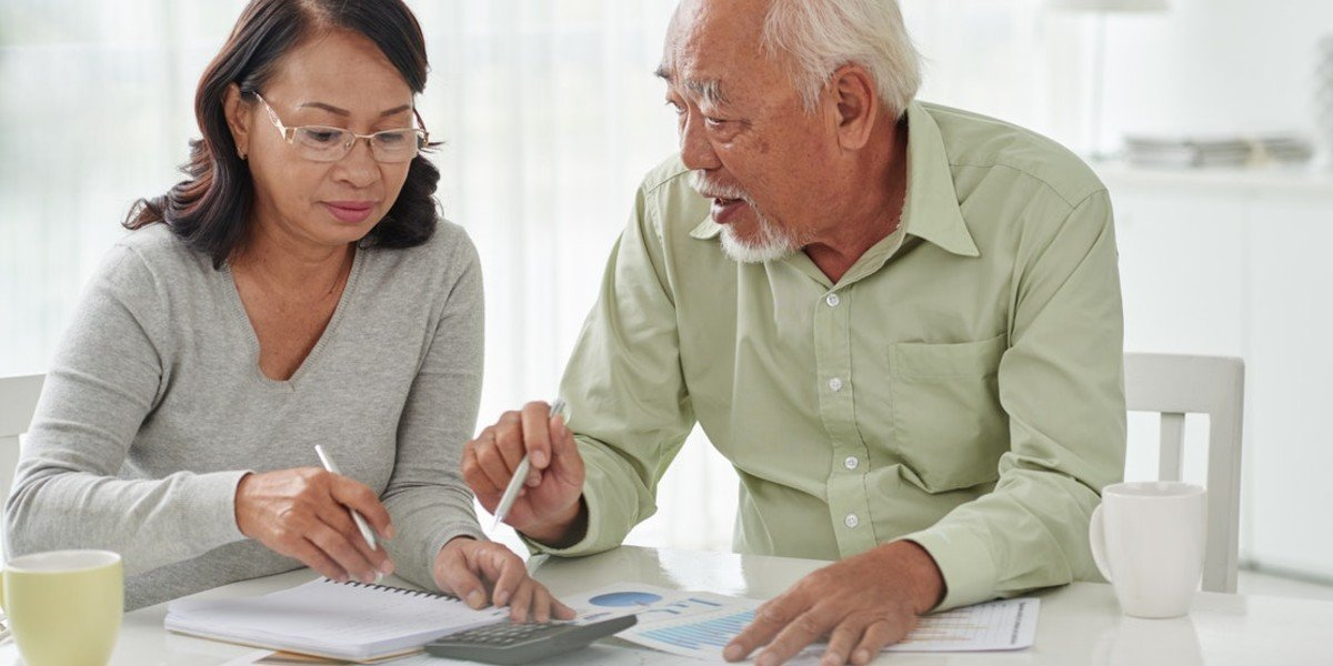 Prepare For The Home Buying Offer In A Seller's Market | Asian couple working