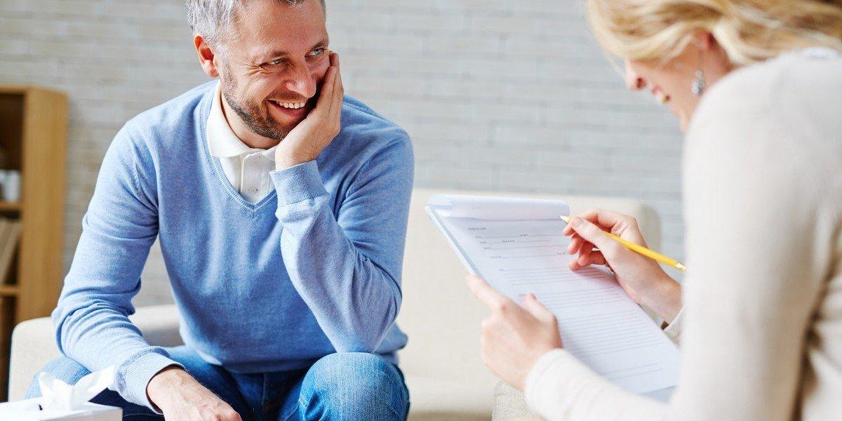 Selling Psychology | man smiling woman taking notes