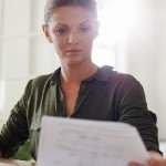 is owner financing a good idea for the seller in | woman looking at papers