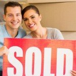 How To Sell A House Off Market | white couple holding sold sign