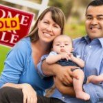 How To Take Advantage Of A Seller's Market | smiling mixed family sold sign