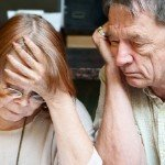 Dealing With Tenants Who Don't Pay Rent   stressed older couple