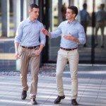 buying investment property | white businessmen walking