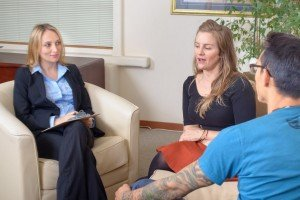 Patience Young Couple Talks with Businesswoman sell my College Station house fast