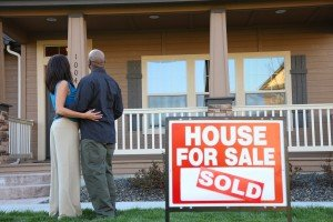 Sell my house fast Calvert | College Station Texas Direct Home Buyers | Couple in front of sold house