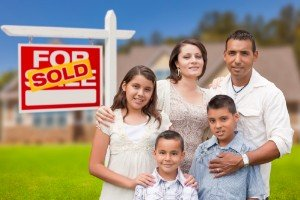 Sell my house fast Somerville | College Station Texas Direct Home Buyers | Couple in front of sold house