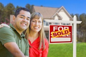 Sell my house fast Brenham | College Station Texas Direct Home Buyers | Couple in front of sold house