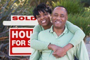 Sell my house fast Hearne   College Station Texas Direct Home Buyers   Couple in front of sold house