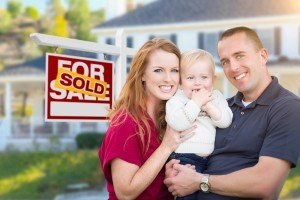 Sell my house fast College Station | College Station Texas Direct Home Buyers | Couple in front of sold house