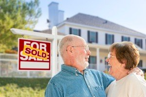 Sell my house fast Caldwell | College Station Texas Direct Home Buyers | Couple in front of sold house