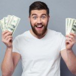 Sell My House Fast In | smiling man holding cash