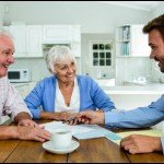 ways to tell real estate agents and investors apart | older couple meeting with agent