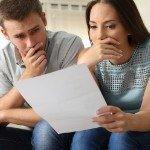 How to Review Seller's Market Offers   shocked couple reading paper
