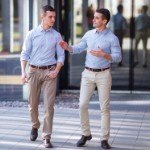 buying investment property | two businessmen walking