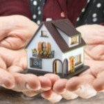 What happens when you inherit a house | hands holding house